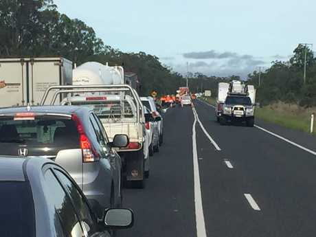 Traffic backed up near the scene of a fatal crash involving a B-Double gas tanker and CVU on the Bruce Highway north of Howard.
