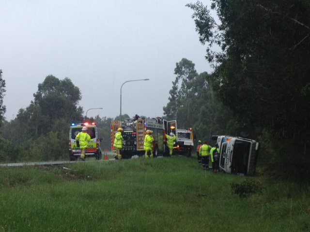 A landscaping truck has rolled on the Sunshine Motorway at Mountain Creek.