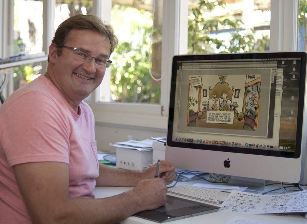 Peter Broelman creating political cartoons from his home studio.
