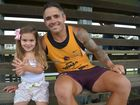 BRONCOS IN TOWN: Brisbane Broncos' Corey Parker stops for a photo with Madison Barrett at Across the Waves Sports Ground. Photo: Max Fleet / NewsMail