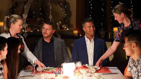Paige and Rosie serve their entree to judges Manu Feildel, second left, and Pete Evans.
