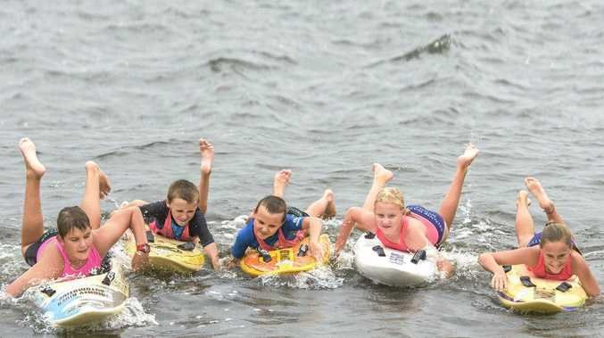 MAKING A SPLASH: Minnie Water Wooli Surf Life saving club members Cody Hinterholzl, Henry Derrick, Bodhi Derrick, Sophie Hinterholzl and Ashleigh Ensbey do some training on the board at Grafton ahead of the NSW Country Surf Life Saving Championships.
