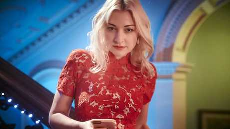 BUSY ARTIST: Kate Miller-Heidke in a scene from the TV series The Divorce, a comedy opera. Supplied by ABC TV.