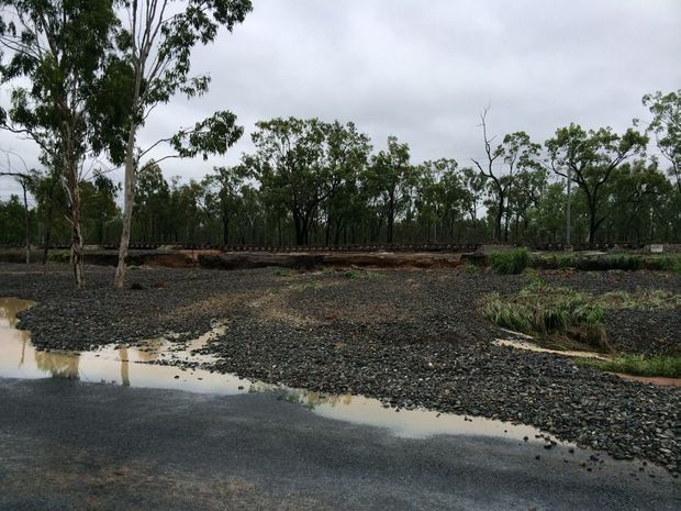 Sections of Aurizon rail line were swept away last night, which could affect coal transport from the Newlands and Goonyella mines. Photo: Isaac Regional Council.