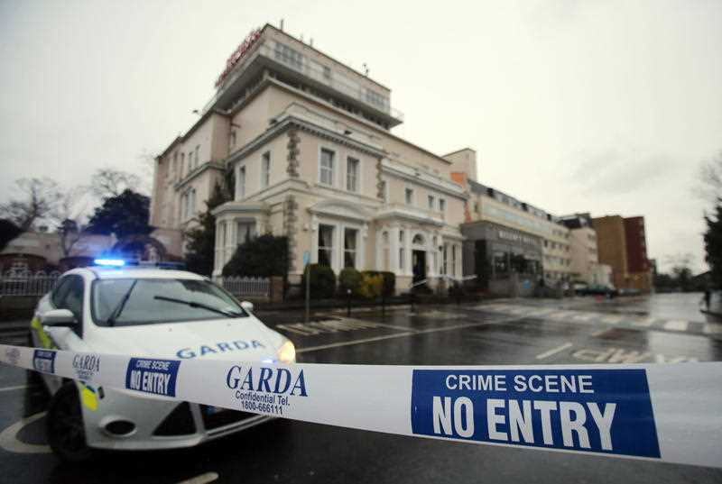 According to witness reports, two gunmen believed to be armed with assault rifles and disguised as police opened fire Friday on boxing fans during a boxing tournament weigh-in at the Dublin hotel, killing one man and wounding two others.