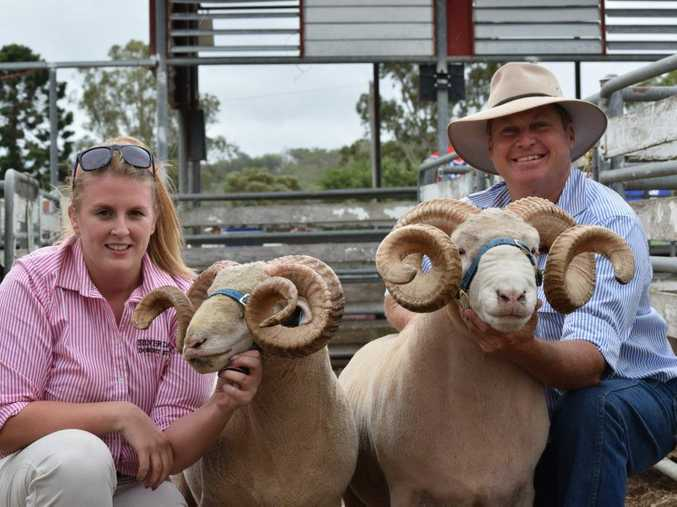 Tracey Bennett and Lyndon Frey from Inglewood with their winning dorset horn rams at the Allora Show.
