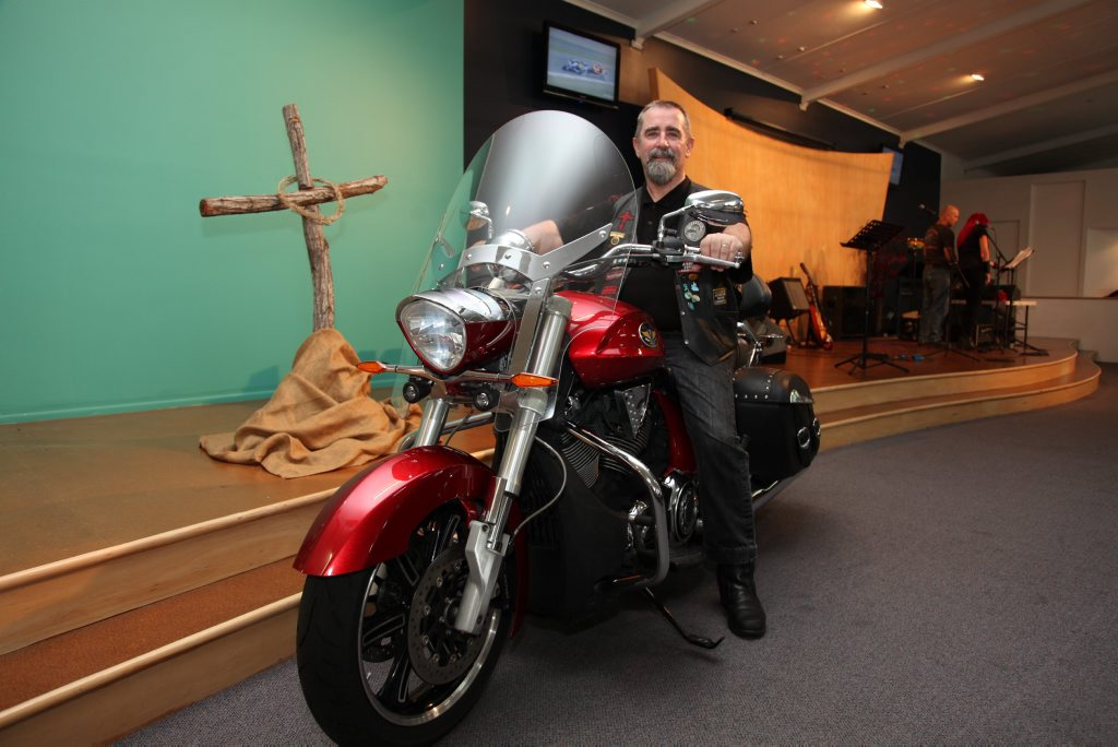 Pastor Dave Woodward gears up for the Biker Blessing at the Door of Hope church in Maryborough on Sunday. Photo: Jocelyn Watts / Fraser Coast Chronicle