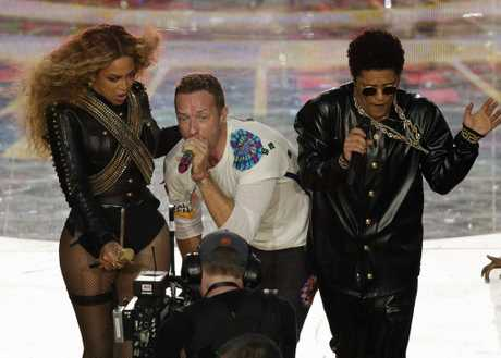 Coldplay singer Chris Martin performs with Beyonce and Bruno Mars during halftime of the NFL Super Bowl 50 football game in Santa Clara, Calif.