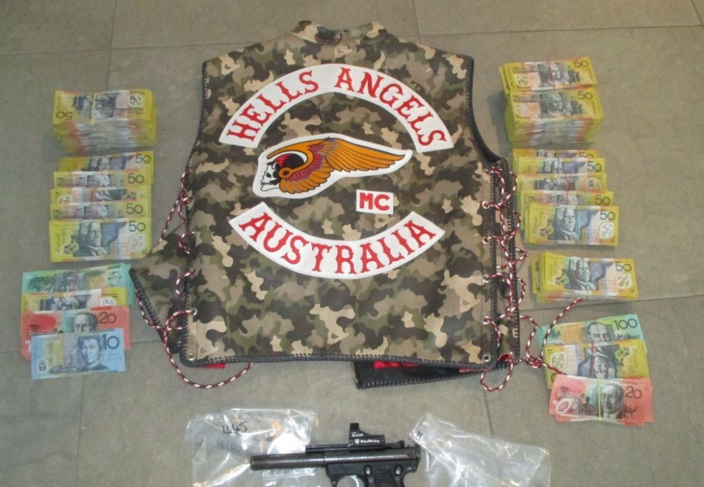 Police allegedly found $158,000 cash, a semi-automatic gun and drugs at the residence.