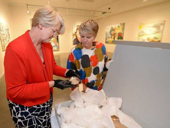 Cr Margaret Strelow and Tracey Cooper-Lavery from the Rockhampton Art Gallery look through Rod Laver memorabilia which Margaret hopes will oneday be on permanent display. Photo: Chris Ison / The Morning Bulletin