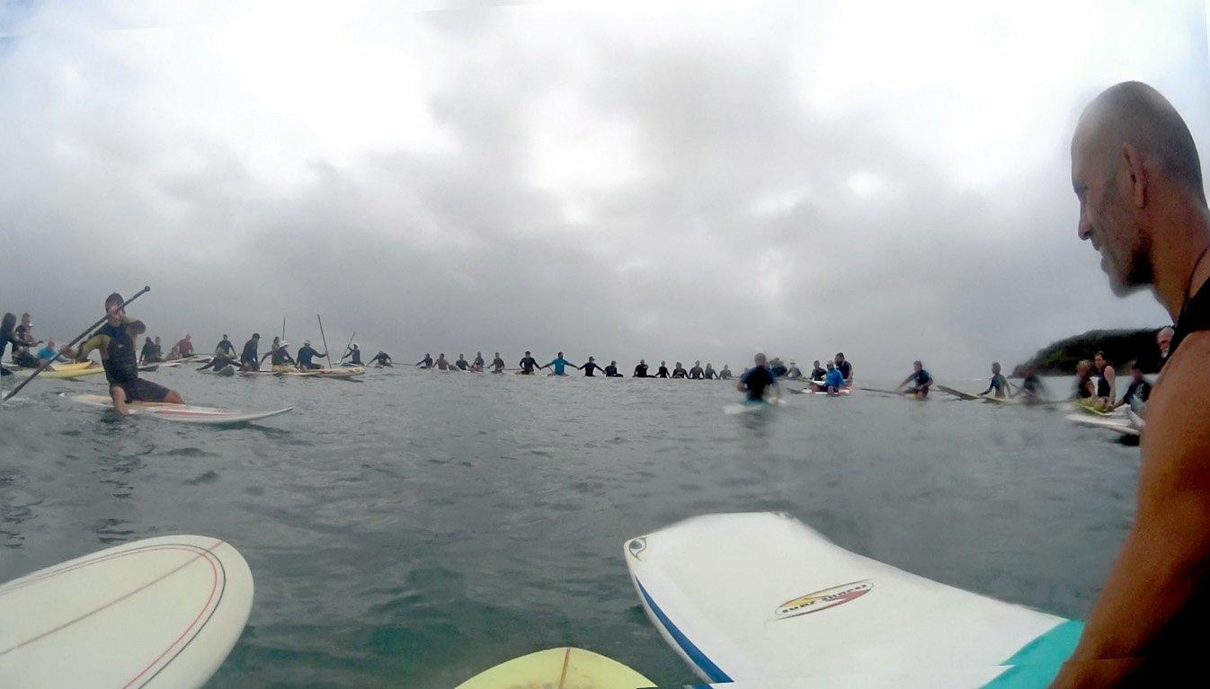FITTING TRIBUTE: Local surfers and stand-up paddleboarders united at Arrarwarra Beach to celebrate the life of well-known surfer, Rod Hocker.