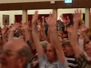 Residents show hands against proposed mine