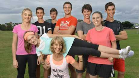 Lil Hogan (front) has twelve children and is running free community fitness sessions in parks across Ipswich. Pictured with her are some of her kids Maree (on shoulders), Elizabeth, Dom, Seb, Joel, Nick, Meg and Marcus Hogan. Photo: Rob Williams / The Queensland Times