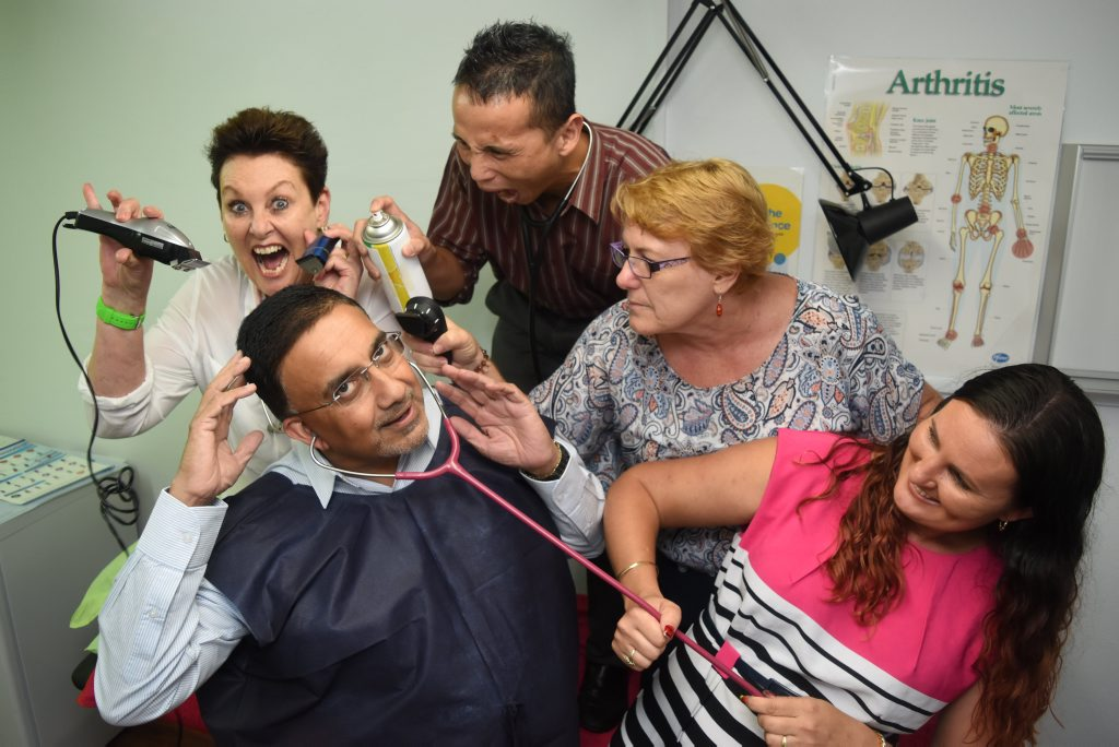 Staff at Gatton's Family Health Clinic (back l-r) Neridah Brynat Richardy Hostiadi, Leanne Ramsay, and (front right) Ellisha Freeman prepare to shave their doctor Mohammed Sultan's hair next month, raising funds for cancer. Photo Ali Kuchel / Gatton Star