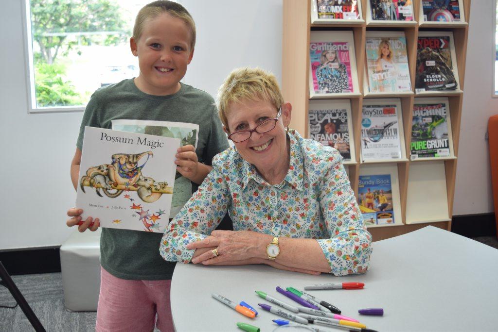 BOOKS DIVINE: Tully Monaghan, 9, meets author Mem Fox at Bundaberg Regional Libraries.