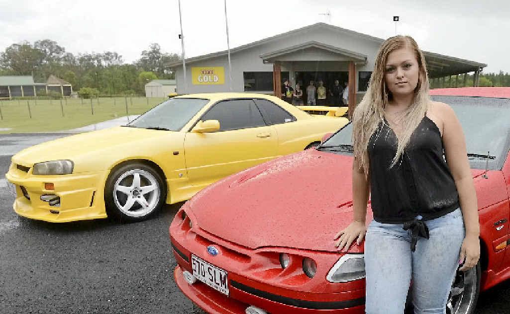 CAR ENTHUSIAST: Samantha Saywell poses with the cars at South Kolan.
