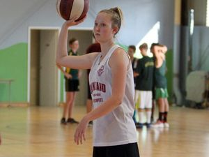 Rouse has a ball of a choice between netball and basketball