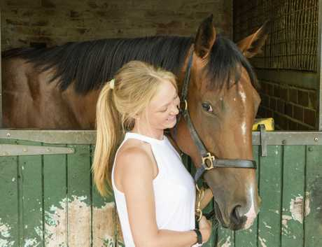 Strapper Leah Kilner with horse Charlee Bear which is racing this weekend.Photo Adam Hourigan / The Daily Examiner