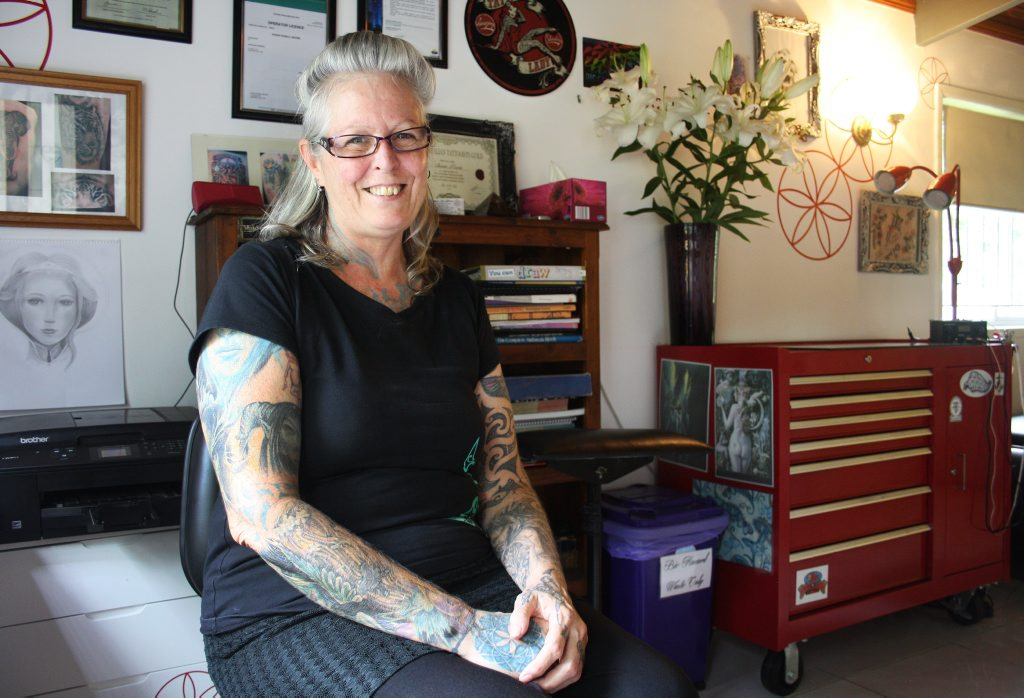 Susan Moore of Moore Love Tattoos is offering free mastectomy scar tattoo cover ups to local women who have endured breast cancer and a mastectomy but cannot afford to get a tattoo cover up or surgical enhancement. Photo: Christine Rossouw / The Logan Reporter