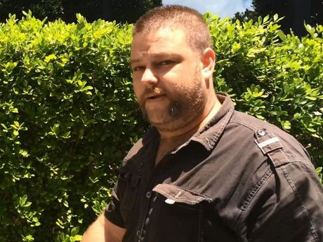 Matthew James Carnie, 37, leaves Maroochydore police station watch house after being granted bail on a charge of assault occasioning bodily harm while armed and in company.
