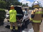 Emergency services at the scene of the car fire in Withcott. Photo Contributed