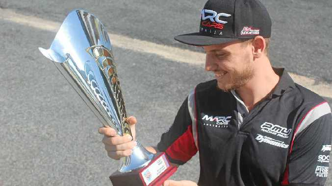 HAPPY MAN: Morgan Haber is all smiles after a successful race at Bathurst where he secured a class win.