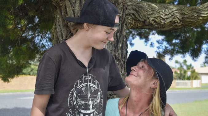 STILL SMILING: Terminally-ill Yamba woman Michelle Baker gets a hug from her 13-year-old son Liam, who has been living with her in tents as they have been unable to find accommodation.