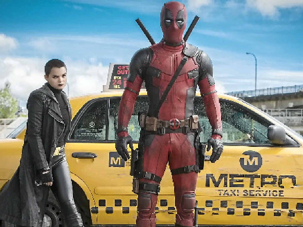 SEEING RED: Brianna Hildebrand (Negasonic Teenage Warhead) and Ryan Reynolds in a scene from the movie Deadpool.