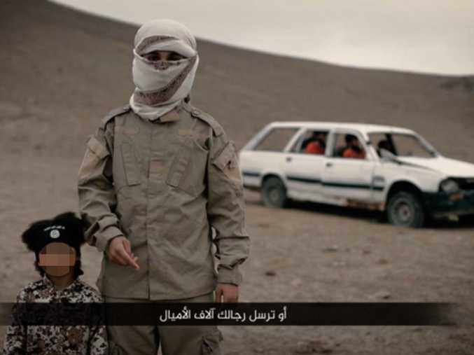 Isa Dare and an unidentified Isis militant believed to be a British teenager in a propaganda video released in February 2016