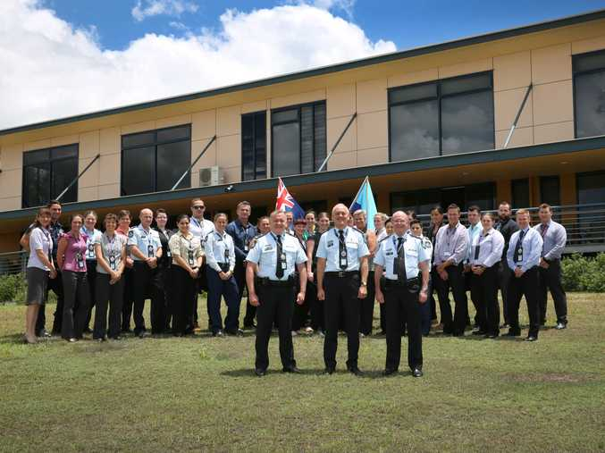 Superintendent David Tucker, Deputy Commissioner Ross Barnett and Assistant Commissioner Paul Stewart with course participants at the QPS Academy, Oxley campus.