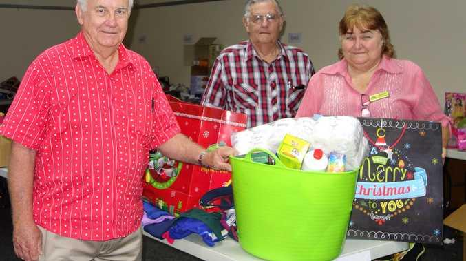 Left to right: Mark Ganter (Branch Treasurer) Charles Achilles (Branch President) presenting Colleen Benson (Manager LECNA) with donation towards hamper distribution.