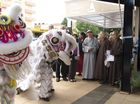 Venerable Master Chin Kung (centre) watches the lion dance at the opening of 360 Peace and Harmony, A Pure Land Learning College exhibition at Toowoomba Regional Art Gallery.
