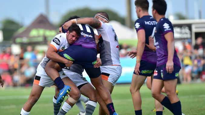 NRL TRIAL: The Storm and the Tigers do battle at Sunshine Coast Stadium.