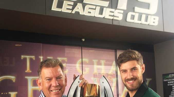 Newly appointed QT sportswriter Ben Wilmott meets Ipswich Jets CEO Wayne Wendt with the club's major trophy from last season.
