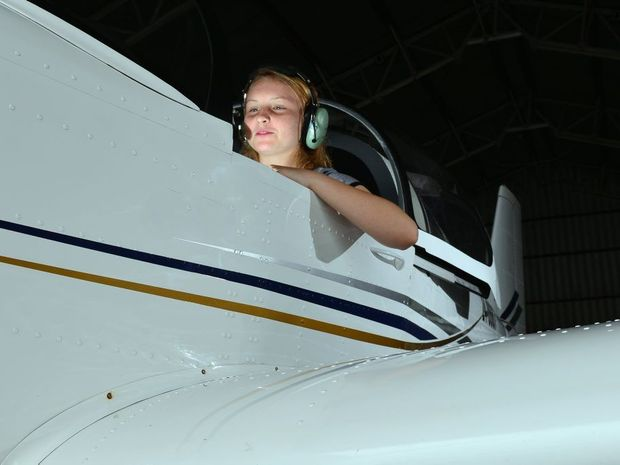 FLYING HIGH: Kyla Burgess, 15, celebrates her first solo flight with her family Christine, Nathan and Lincoln Burgess. John McCutcheon