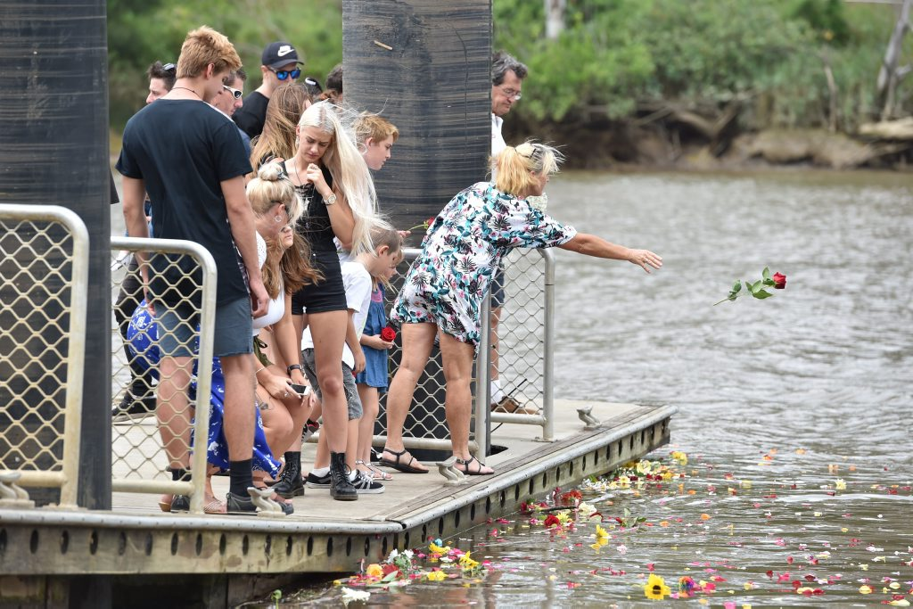 Memorial service for Joel Winterton at the park below the Lamington Bridge where he drowned. Friends farewell him with a floral tribute from the pontoon he was fishing from. Photo: Alistair Brightman / Fraser Coast Chronicle