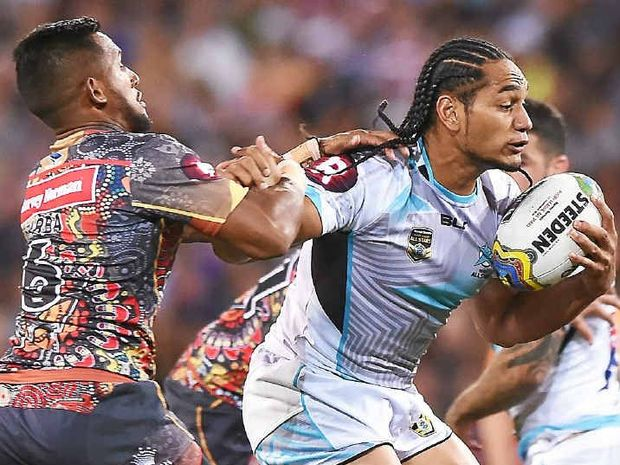 HOLDING ON: Martin Taupau is tackled by Ben Barba at Suncorp Stadium on Saturday.