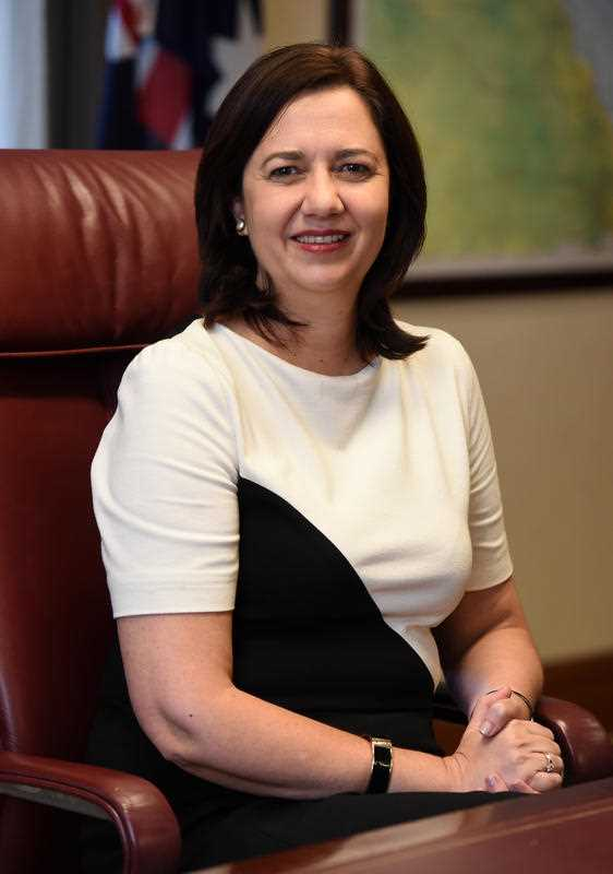 Queensland Premier Annastacia Palaszczuk poses for photos in her office in Brisbane, Sunday, Feb. 14, 2016. Today marks one year since Ms Palaszczuk took office.