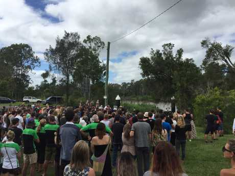 About 300 family, friends, emergency services and strangers met near the Lamington Bridge ramp to pay their respects to Joel.