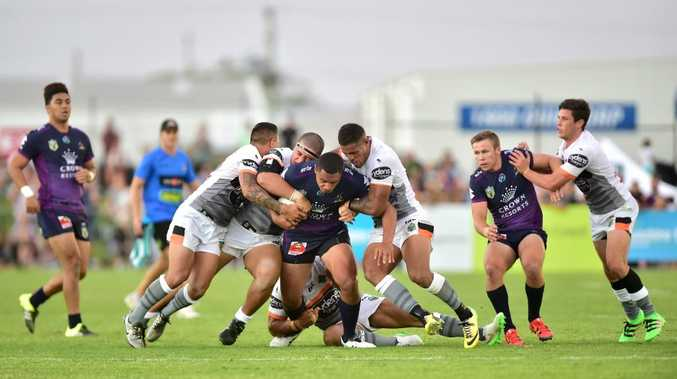 NRL trial match between Melbourne Storm and Wests Tigers at the Sunshine Coast Stadium. The Tigers defence was strong.