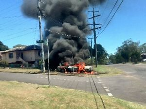 INFERNO: A 28-year-old Leichhardt woman escaped the fire that engulfed her Mitsubishi Magna after she allegedly set fire to it herself.