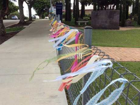Ribbons showing support for victims of child abuse.
