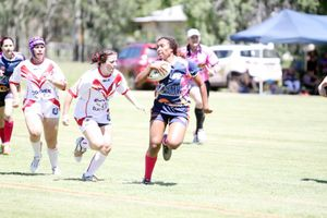 Crushettes' winger Justine Willie successfully evades a would be tackle. Photo Matty Holdsworth / CQ News
