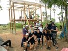 CAMBODIA: Students from Byron Bay High with one of the homes they helped construct.