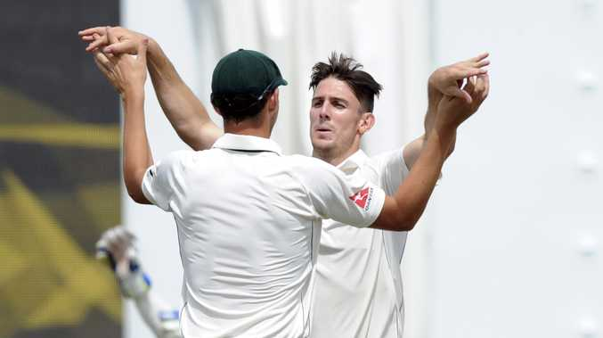 Mitch Marsh takes one of his three wickets in the New Zealand second innings. Photo: AAP Image.