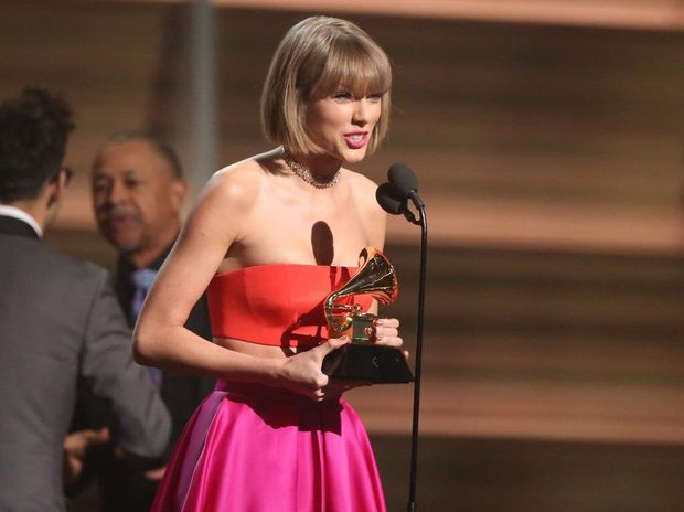 Taylor Swift accepts the award for Album of the Year for 1989 at the 58th annual Grammy Awards in Los Angeles.