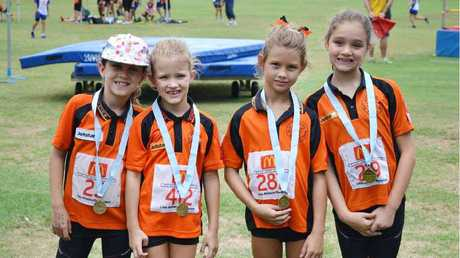 Under 8 Ipswich girls with their participation medals at the Metro West championships.