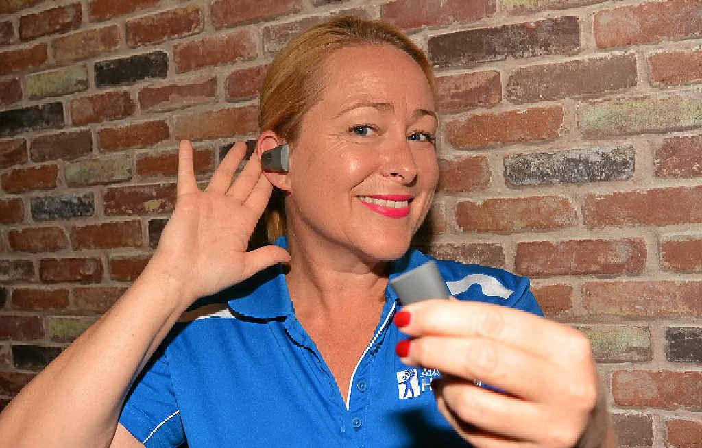 Australian Hearing's Gold Coast manager Karina Morrison demonstrates the innovative