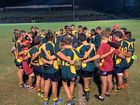 HUDDLE: The Darling Downs boys talk tactics for a Junior Gold rugby union game.