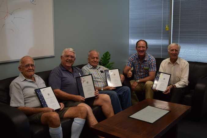 LIFETIME OF WORK: The JPs receiving awards in Buderim MP Steve Dickson's office.